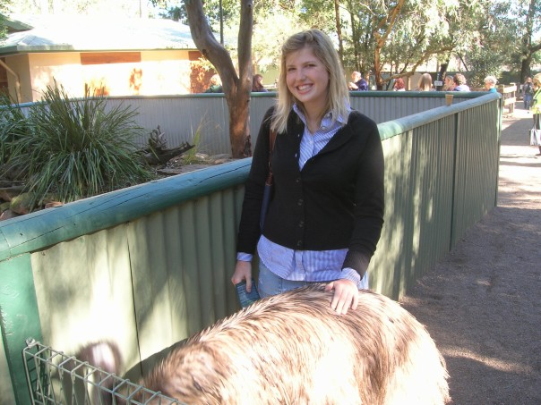 Me with the butt of an emu. I think they can be really mean, but he didn't mine me touching his butt.